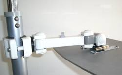 universal LCD monitor pole arm that can be aimed at the floor