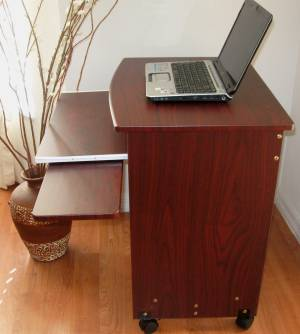 When Used For A Notebook Computer, The Laptop Is Generally Placed In The  Top Shelf. The Sliding Keyboard Shelf Is Used For Writing Space Or For  Literature.